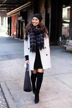 Kat Tanita looks ultra glam in this combination of thigh high boots, a white double breasted coat, and a simple pattered scarf. Add a beanie to keep your look perfectly suited for the winter. Outfits Otoño, Fashion Outfits, Casual Outfits, Fashion Tips, High Street Fashion, Street Style, Fall Winter Outfits, Autumn Winter Fashion, Winter Style