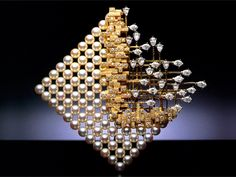 """1969 Mikimoto wins DeBeers Diamonds International Awards The Diamond International Awards are the most prestigious awards for jewellery design in the industry. The brooch """"Prelude to Space"""", wins the award, a first for Mikimoto."""