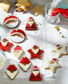 Transform cookie cutters in simple shapes—diamonds, triangles, stars and circles—into a jolly array of Santa cookies. #recipe #dessert #christmascookies #decoratedcookies #bhg