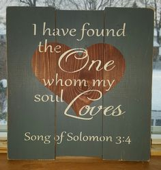 """10"""" x 11"""" wooden sign Song of Solomon 3:4 is the scripture verse on this pallet sign. A grey-blue background with stained wood heart and off-white lettering. C"""