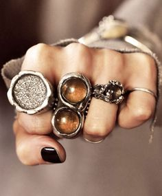 """Double crystal dome ring set in a coiled snake setting, with the moon, alchemy and goddess symbols inscribed. The Smoky Quartz is a good stone for protecting against negative energy and transforming it into positive energy. Length is 1.5"""" long and 7/8"""" wide. Available in brass or silver plated brass. Hand made by MANIAMANIA."""