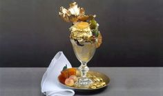 "Golden Opulence Sundae most expensive food- This Sundae includes a edible gold leaf, rare chocolates and ice cream, served in a crystal goblet with an gold spoon. It also holds the Guinness World Record for ""Most Expensive Sundae. Most Expensive Ice Cream, Most Expensive Food, Expensive Cars, Chocolate Truffles, Chocolate Syrup, Haute Chocolate, Frozen Chocolate, Chocolate Covered, Gourmet"