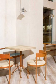 The Madrid-based architecture firm Lucas y Hernández-Gil has reshaped a compact corner in the city's residential Retiro and Salamanca neighbourhoods to form a light-filled café and bakery. The highlight is the hand-painted yellow and white square tiles. Restaurant Furniture, Restaurant Interior Design, Restaurant Chairs, Cafe Interior, Restaurant Interiors, Cafe Furniture, Interior Office, Interior Paint, Restaurant Madrid
