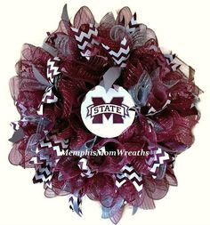 Alright, Mississippi State fans: it time to get your front door ready to HAIL STATE with this gorgeous Mississippi State Deco Mesh Wreath. This 26 diameter wreath features a 14 white pencil work form, and 10 burgany, white, and silver/gray deco meshes. Gorgeous burgundy grosgrain chevron makes the whole thing pop as does the handmade MSU logo sign. Double doors? Want one for yourself and one for a fellow MSU fan? We can easily double your order--just message us or click Request Custom ...