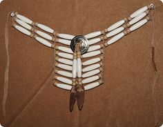 """The choker is 13"""" by 6"""" in length and is made out of plastic beads, brown leather strips and one indian arrowhead."""