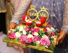 Show your creativity by creating a beautiful engagement ceremony plate with these gorgeous plate decoration ideas for engagement. Indian Wedding Gifts, Desi Wedding Decor, Wedding Reception Backdrop, Outdoor Wedding Decorations, Stage Decorations, Wedding Mandap, Wedding Stage, Wedding Receptions, Wedding Ideas