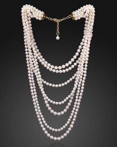 Assael Sunset 7 Row Akoya Cultured Pearl Necklace with Diamond pave spheres placed intermittently.