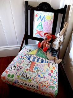 Wonderful idea for a child's chair.  Covered in canvas, the parents allowed the child to draw on the chair with fabric pens.  They wrote a special note to him on the back of the chair along with this birthdate.  Sweet!