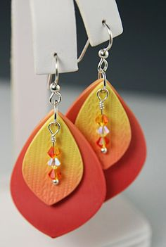 Here's something else I'm playing around with right now. These earrings are longer and larger than my usual pieces. Somehow, the double la...