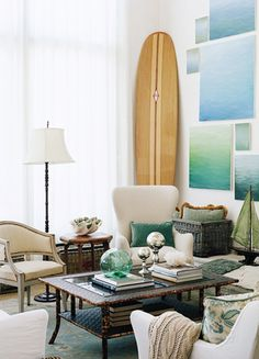 21 Homes That Prove Surf Is Chic // surfboards as decor // ocean water artwork, traditional living room