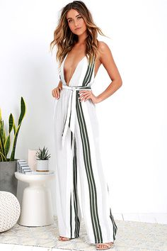 Every chic style seeker's wardrobe will benefit from the Faithfull the Brand Citizen Grey Green Striped Jumpsuit! Light and breezy woven rayon has grey and grey-green stripes over the tying triangle bodice (with plunging neckline). Smocking and attached sash at the waist top the relaxed pants. Hidden back zipper/clasp.