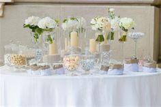 Beautiful cream and white candy buffet. Wedding candy