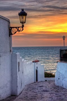 Mediterranean sunset in Nerja, Spain - Nerja is a municipality on the Costa del Sol in the province of Málaga in the autonomous community of Andalusia in southern Spain. It belongs to the comarca of La Axarquía.