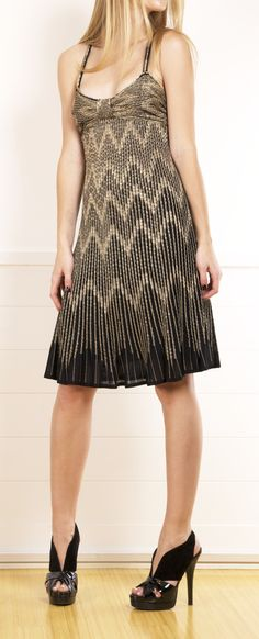 Christian Dior Knit Black/Gold Lurex Sleeveless dress. This flirty dress is a knit black with light gold threading throughout.