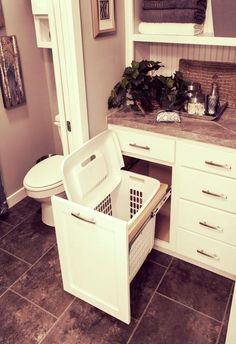 Pull-out hamper in the bathroom, clothes go straight in before a shower