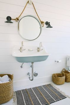 Coastal interior ideas & colours. Kids bathroom with blue Kohler Brockway Sink and shiplap walls. Rita Chan Interiors.