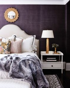 I live the eggplant against the white! Grasscloth wallpaper, eggplant. White side tables