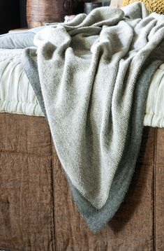 Blended from an Alpaca and wool mix, the Komorebi charcoal knitted throw is super soft to snuggle up under Bed Linen Design, Bed Design, Linen Fabric, Linen Bedding, Dappled Light, Knitted Throws, Fine Linens, Contemporary Interior, Charcoal