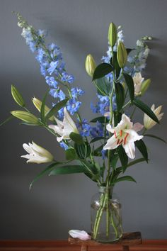 A tall bouquet of lilies and delphiniums and a floral give away | Madame love
