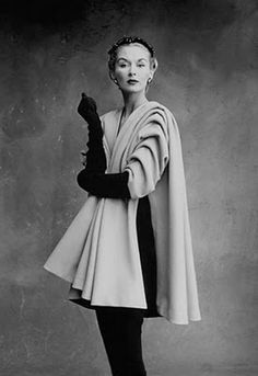 Vogue, September 1950  (photograph by Irving Penn).  In the mid-1950s, Balenciaga began further experimenting with silhouettes leading to what is highly regarded as his most inventive (and most influential) period. He began broadening the shoulders, cropping the sleeves, and removing the cinched-waist. The shapes gained more volume and drama, becoming Balenciaga's signature look.