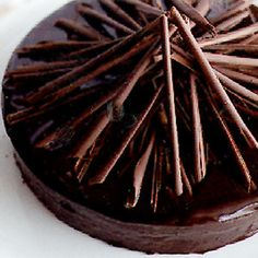 "Flourless Chocolate Cake with Espresso Icing Recipe (gluten-free). This cake is known as ""Queen Mothers Cake"" and is Maida Heatter's most popular recipe ever. Best Chocolate Desserts, Köstliche Desserts, Delicious Desserts, Passover Desserts, Passover Recipes, Decadent Chocolate, Melted Chocolate, Delicious Chocolate, Holiday Desserts"