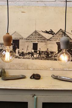 Unique little bulb pendants lights with either a #cork or #concrete base.