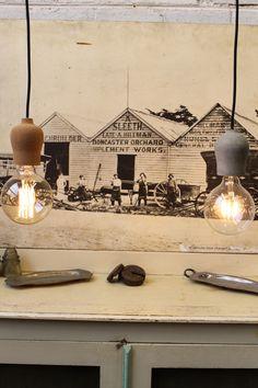 Unique little bulb pendants lights with either a #cork or #concrete base.