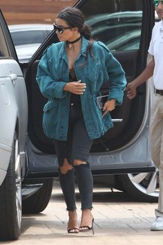 Kim Kardashian West in Givenchy, J Brand, and Manolo Blahnik - The mother of two continued to highlight her post-baby physique in skinny jeans and a corset-like top, but it was the overdyed and slouchy cotton jacket that stood out as the cool counterpoint to Mrs. West's off-duty look.