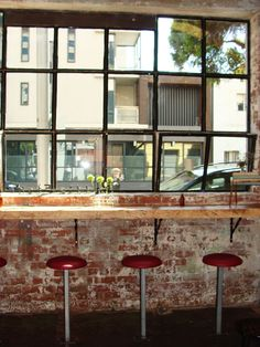 Large window with bar seating. Rustic/industrial. Love this.