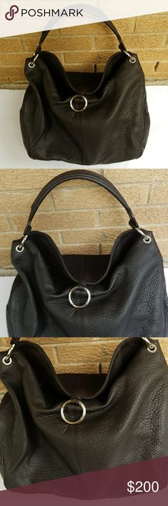 """🎈SALE🎈Authentic Escada Sport leather purse Escada Sport deepest cocoa brown color (looks black) Genuine pebbled and durable leather.  Large Hobo style. Bottom corners black vegan leather with Escada logo silvertone hardware.  Magnetic closure.  Very roomy.  Inside zip pocket. Excellent condition inside and out. Beautiful luxury purse. W-15"""" L-12.5"""" Depth- 8.5"""" drop strap  13"""". From smoke free home. Escada Bags"""