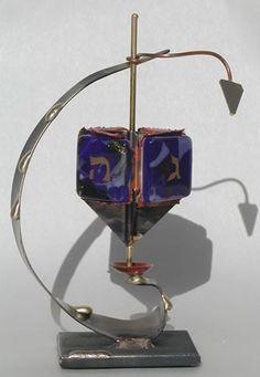 Gary Rosenthal Curved Dreidel. $70. http://www.jewishgiftplace.com/Gary-Rosenthal-Curved-Dreidel.html
