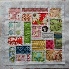sweet little scrappy hand-quilted quilt.  would be a great little doll quilt for a Christmas gift for the girls