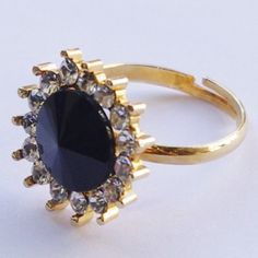 Golden ring with black and white crysral http://enewmall.com/women-rings/