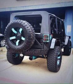 Black Jeep with a touch of teal