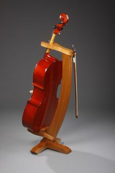 This solid cherry cello stand is the perfect piece to showcase your instrument. A classic piece that will fit in any room setting with the use of tra… Violin Stand, Wood Guitar Stand, Music Stand, Cellos, Cello Music, Sculpture Stand, Pallet Painting, Wooden Case, Wood Furniture