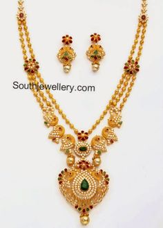 22 carat gold beautiful peacock design gundla haram studded with cubic zircons, rubies, emeralds and south sea pearl drops. Gold Bangles Design, Gold Earrings Designs, Gold Jewellery Design, Necklace Designs, Gold Haram Designs, Gold Designs, Gold Jewelry Simple, Indian Jewelry, Indian Necklace