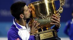 Serbia's Novak Djokovic kisses the trophy after winning the men's singles final against France's Jo-Wilfried Tsonga at the China Open tennis tournament in Beijing (Reuters)