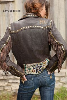 This awesome leather jacket! I want...The jeans aren't bad either. With a pair of boots. Oh yeah!