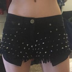 Black studded shorts Super short, super cute black studded shorts. XS. Pockets hang out past material. Perfect for concerts and festivals. Not nasty gal, just for views. They're reverse brand. Nasty Gal Shorts Jean Shorts