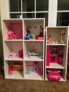 The perfect homemade barbie house! Shelving from Target, thumb tacks & scrapbooking paper