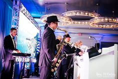James Bond tribute Band in Orlando, Florida. James bond theme entertainment for your James Bond theme event. James Bond Theme, Corporate Entertainment, Trumpet Players, Orlando Florida, Theme Song, Corporate Events, Orchestra, Entertaining