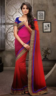 Stylize your ethnic look draping this pink and red chiffon faux georgette saree. The saree is aggrandized with fancy color gradation all over. The fancy zari embroidered patterns on the contrasting saree border create a mesmerizing look to this attire. #EveningWearSaree
