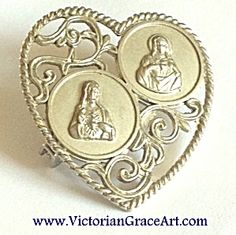 $35  To Jesus through Mary Heart shaped pin featuring the Sacred Heart of Jesus and the Immaculate Heart of The Blessed Mother, Virgin Mary. Silv...