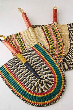 African Market Baskets Hand-Woven Bolga Fan; it's either these or air conditioning.