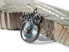 Blue Topaz Necklace  Silver Wire Wrapping  by NurrgulaJewellery
