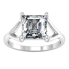 A split shank solitaire engagement ring is a most elegant yet simple way to present a center diamond.  Without the extra ornamentation or pizzazz from accent diamonds, it allows an immaculately perfect center diamond to shine on its own in all of its own glory.  The diamond is prong set with prongs that rise from the split in the band which starts about a third of the way down.  The circular shape of the ring continues beyond the rise of the prongs underneath the diamond creating bands that…