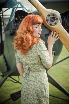 vintage style, fashion, red hair, dress, full fringe, curly hair, floral, 1940s, ww2
