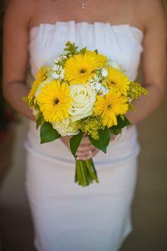 Bright yellow Gebera Daisies and roses