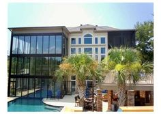 This home's glass addition separates the indoor and outdoor pools, amazing! Diamondhead, MS  $1,750,000