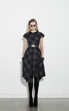 Wrap-around dress in turquoise tartan flannel, Black tights with khaki heels and Black suede pumps by Carven. http://carven.fr/cms/en/collection/winter-2011#look_id=413